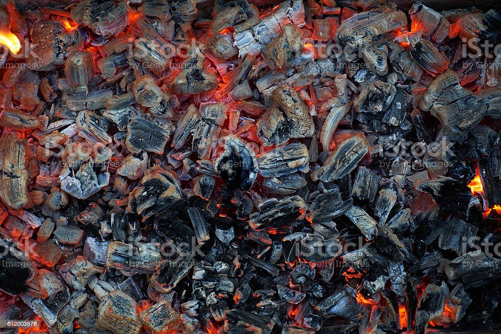 Blazing red coals. Beautiful background. stock photo