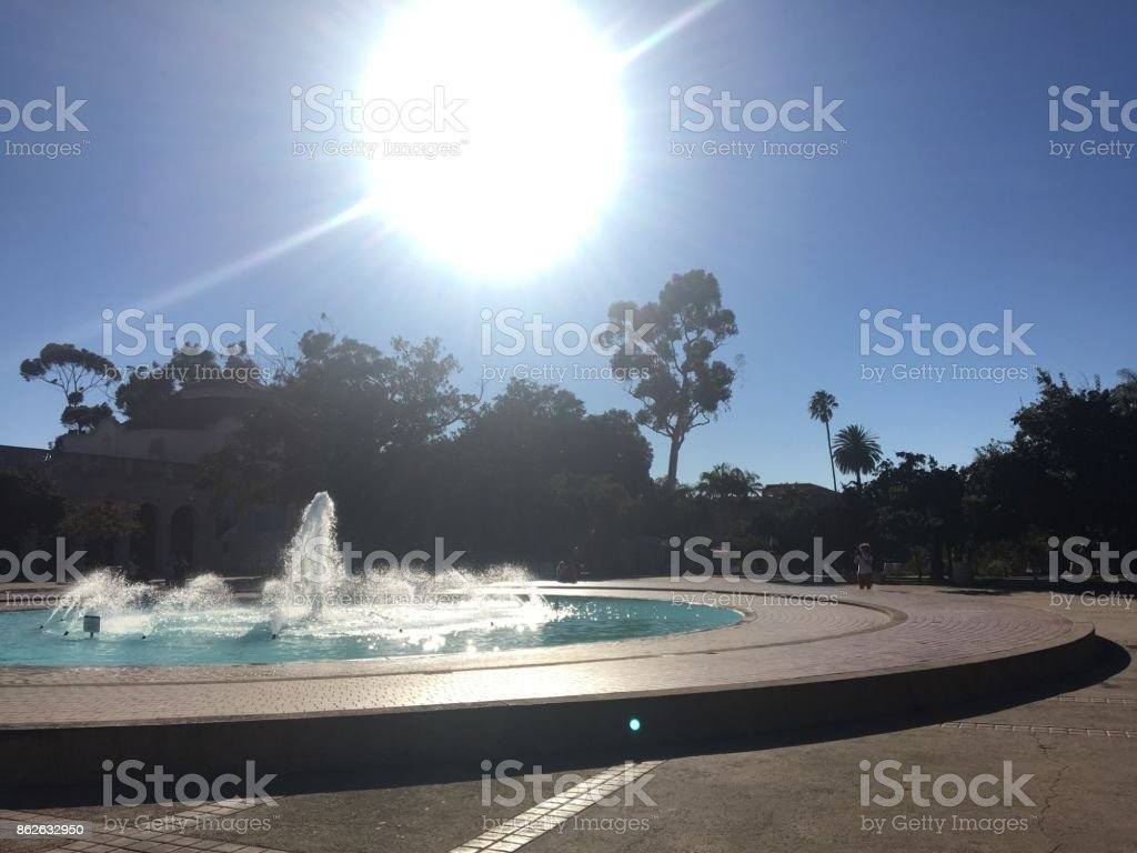 Blazing Sun over Outdoor Fountain stock photo