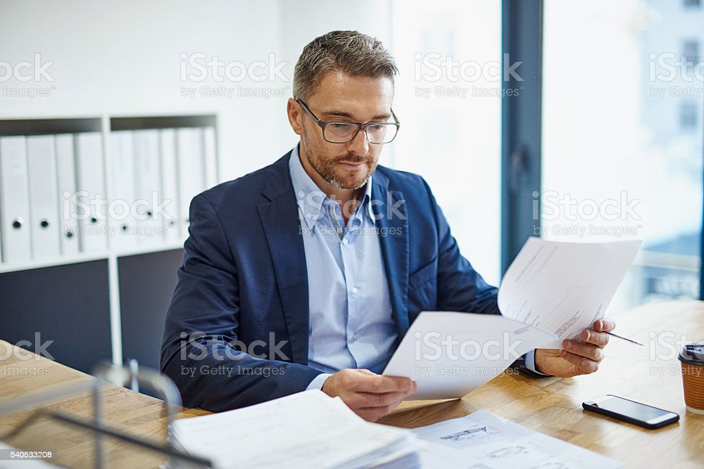 Blazing through his paperwork stock photo