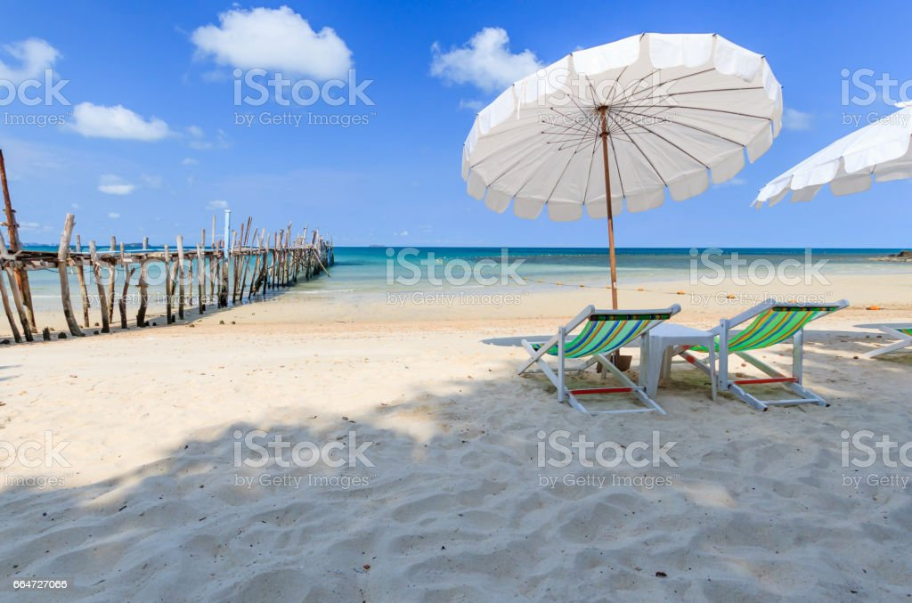 Bleach chair with the white umbrella on the bleach at Samet Island, Thailand stock photo