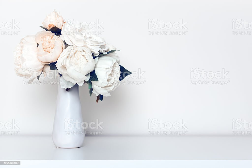 Bleached Peonies In Vase stock photo