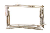 Frame with copy space made from sun bleached drift wood isolated on white background.