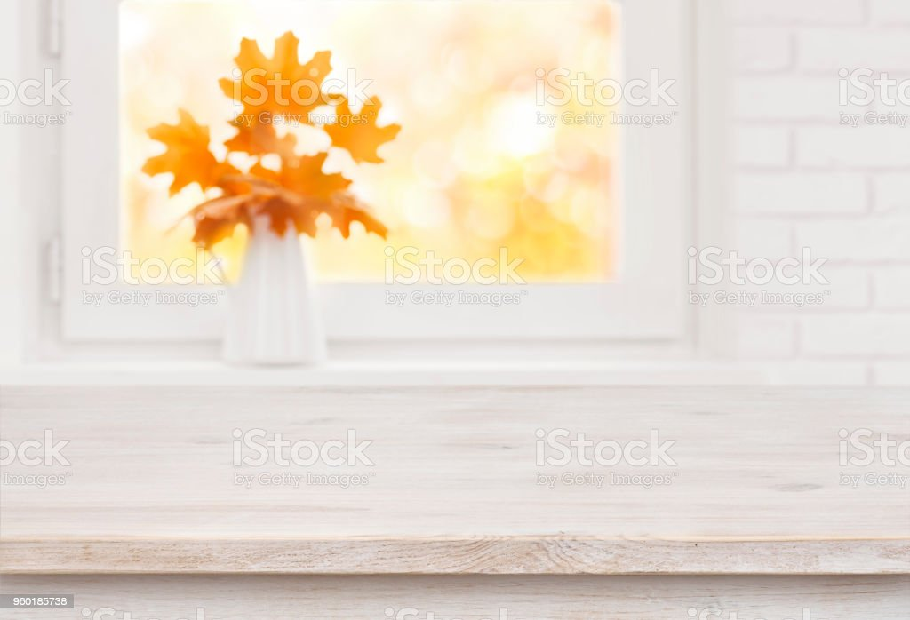 Bleached wooden table on the background of white autumn windowsill stock photo