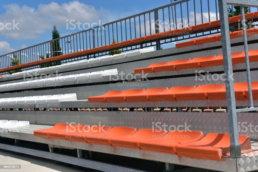 Bleachers in a football stadium, detail of a sports venue, seating...