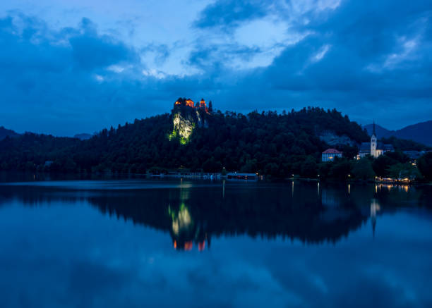 Bled Castle reflecting in Lake Bled at Night stock photo