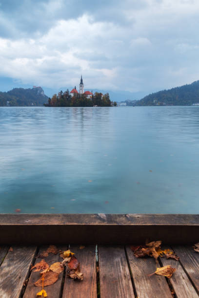 Bled lake in Slovenia with island and Pilgrimage Church of the Assumption of Maria stock photo