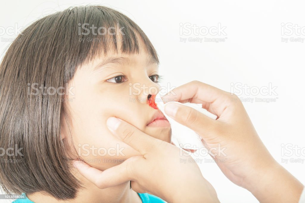 Bleeding in the nose of the child and clean hands stock photo