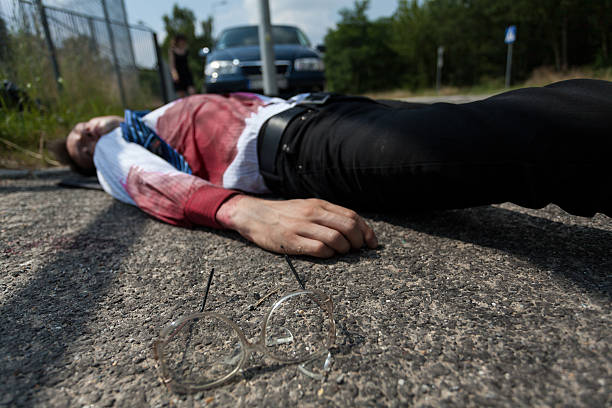 Bleeding man lying on the street stock photo