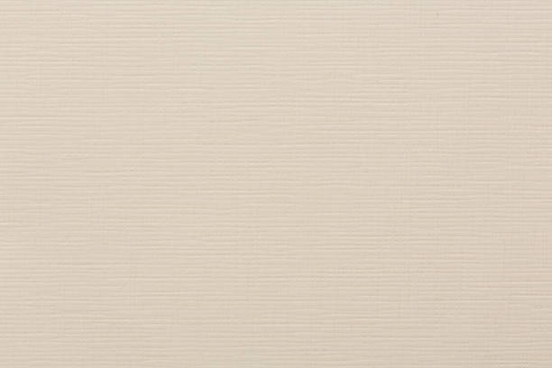 Blended beige paper texture pattern background in light yellow c stock photo