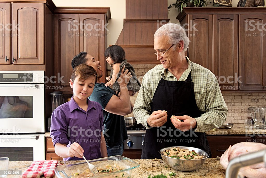 Blended Family preparing thanksgiving dinner together stock photo