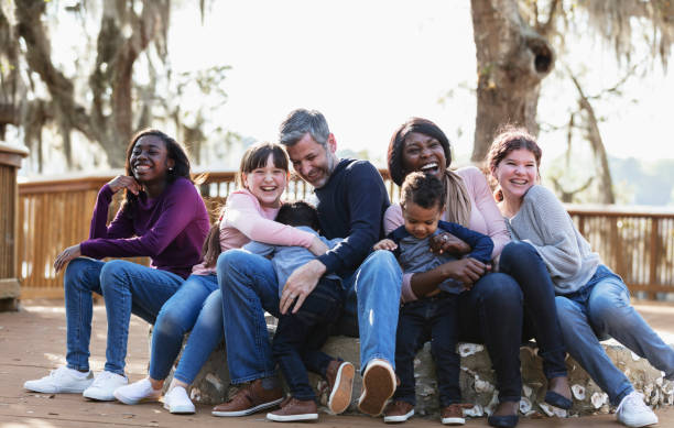 Blended family with five children outdoors at a park stock photo