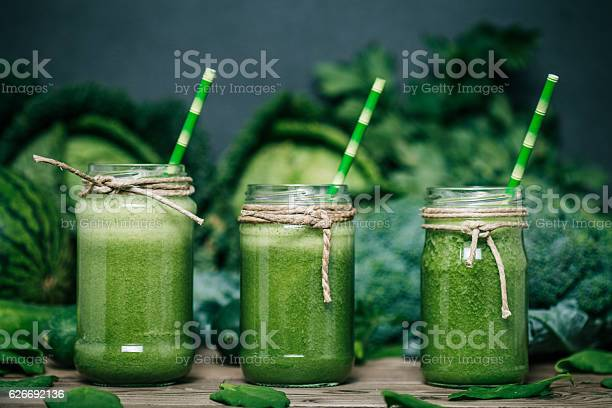 Blended green smoothie with ingredients on wooden table picture id626692136?b=1&k=6&m=626692136&s=612x612&h=o3gti9mlccu119rfx6tsfvsm6rmkxibf1kcmmwlr3x0=