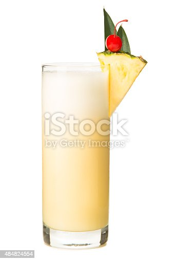 Blended Piña Colada Smoothy isolated on White background with slice of pineapple and cherry.