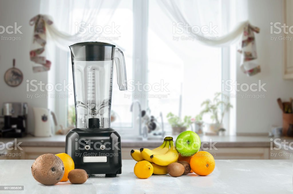 Blender and fruits on kitchen space. Still life