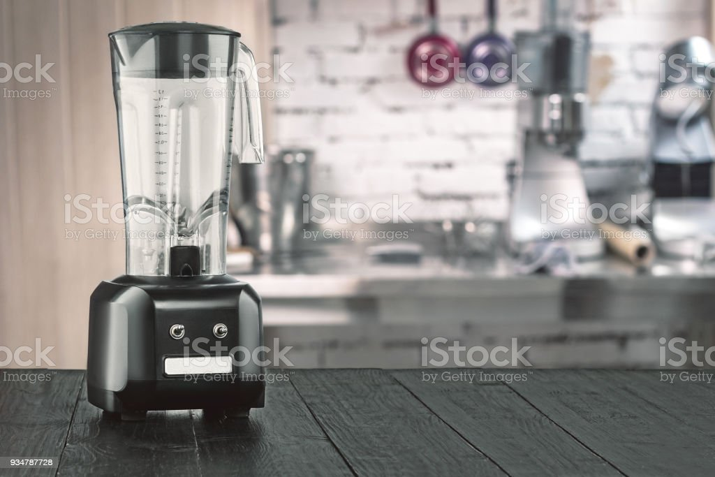 Blender and wooden table in kitchen stock photo