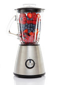 """""""Blender filled with Berries -  a fruit shake waiting to happen - Strawberries & BlueberriesIsolated on white background, reflection on the floor."""""""