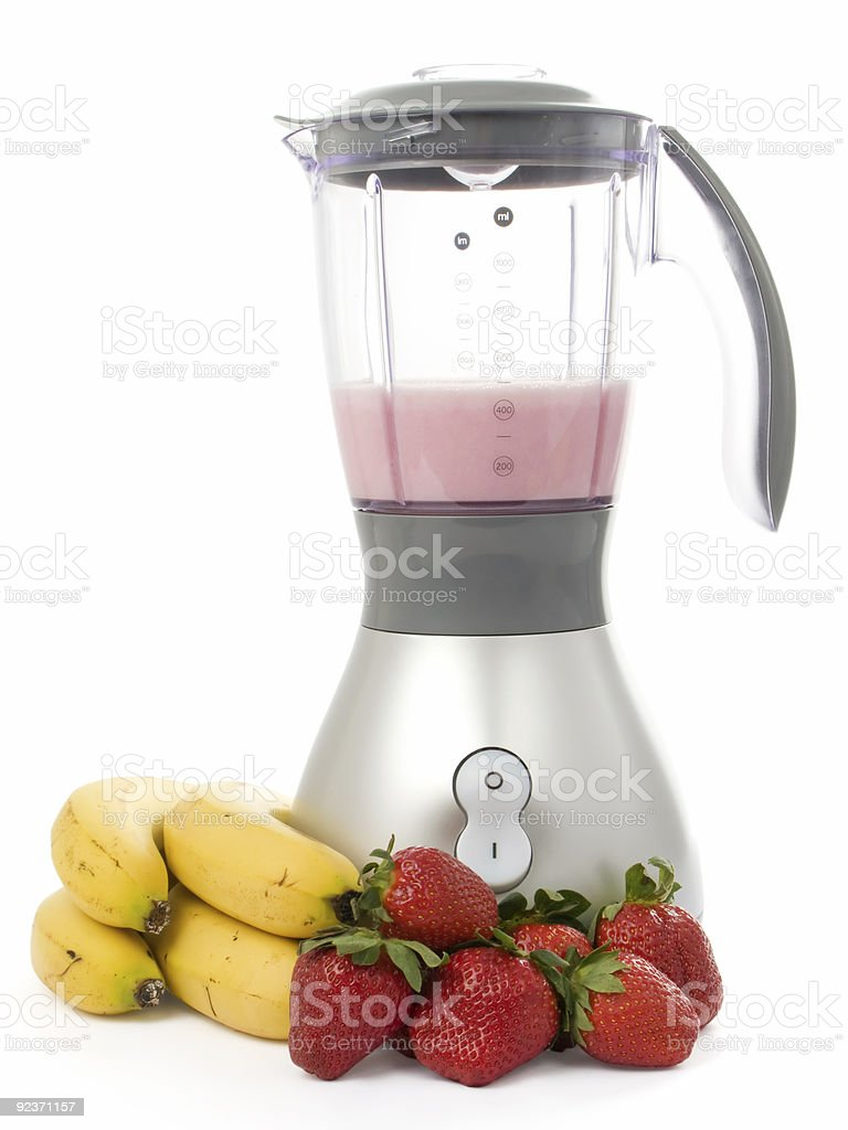 Blender with strawberries and bananas royalty-free stock photo