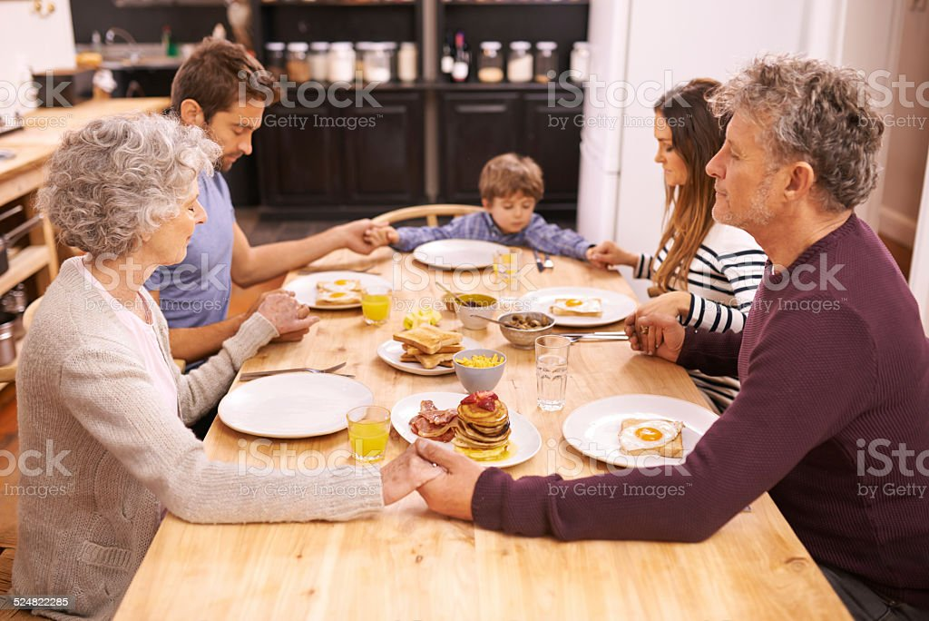 Bless this food to our bodies stock photo