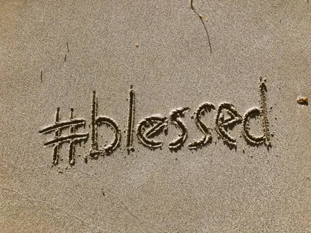 Blessed Message Written in Sand stock photo