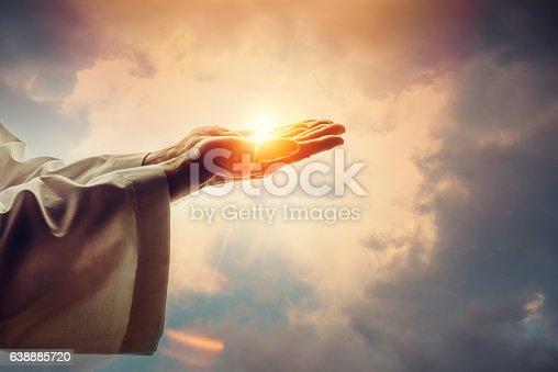 Male hands holding sunlight