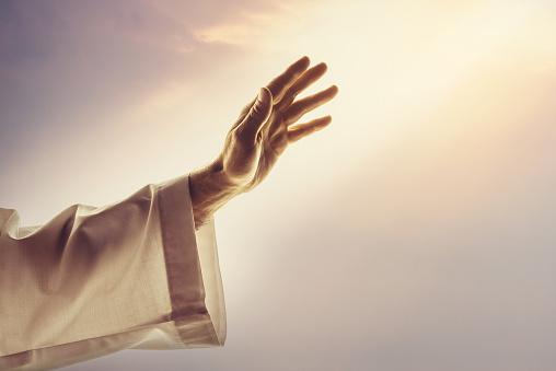 Male hands reaching sunlight