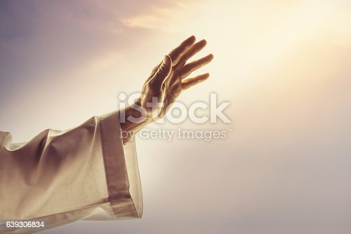 Male hands reaching sunlight