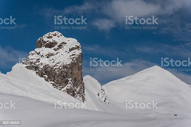 Arosa, Switzerland - January 21, 2015: Hörnli, a landmark in the Swiss Alps with snow and a blue sky.