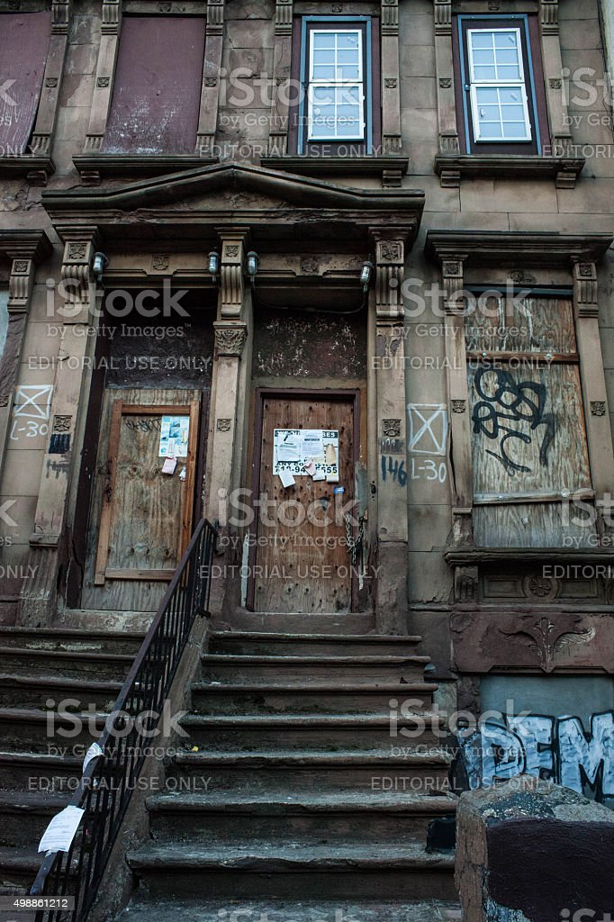 Blighted boarded up brownstone in Harlem. 151 W 29th. stock photo