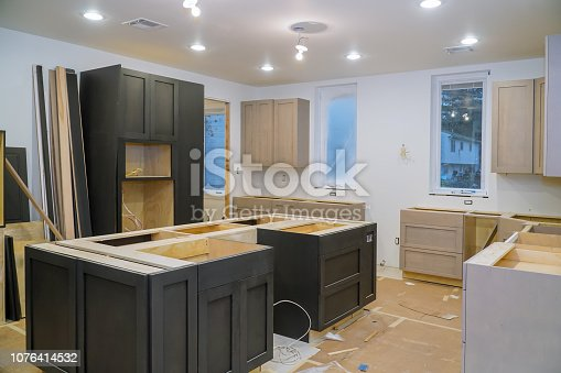 1070686034 istock photo Blind cabinet, island drawers and counter cabinets installed 1076414532