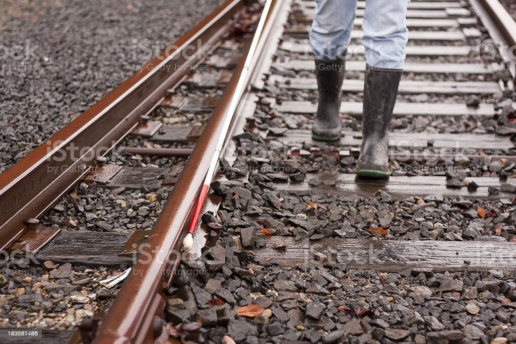 Blind Cane User On Railroad Tracks stock photo