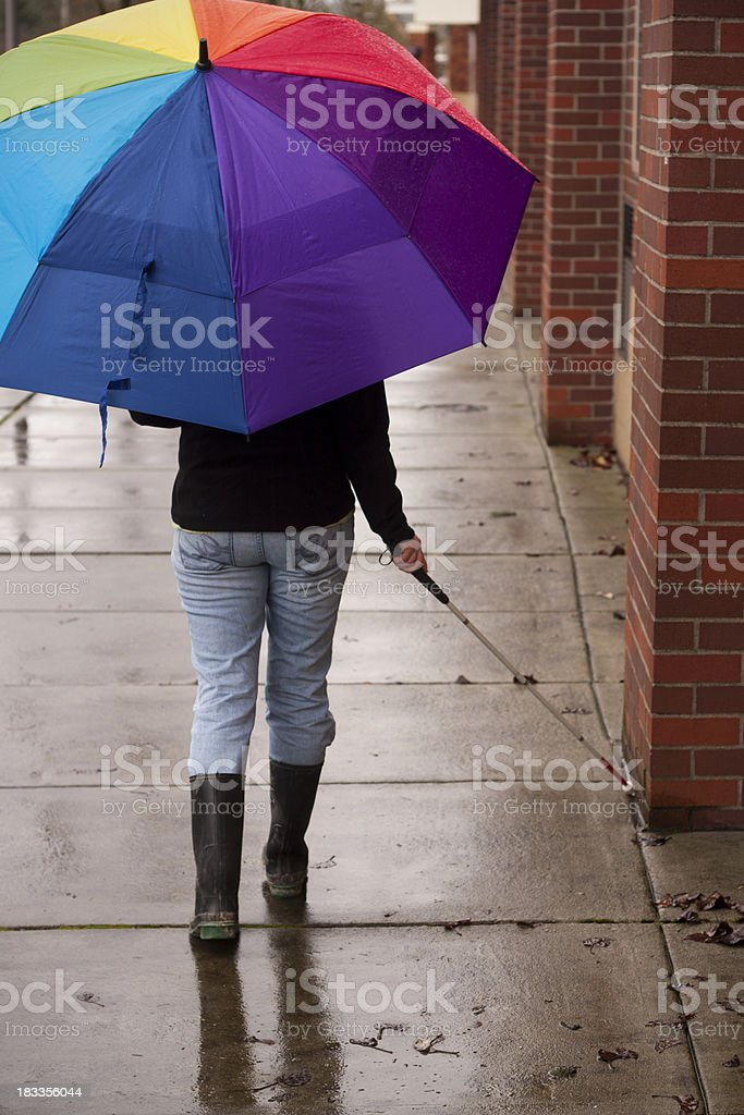 Blind Cane Userwith Bright Umbrella stock photo