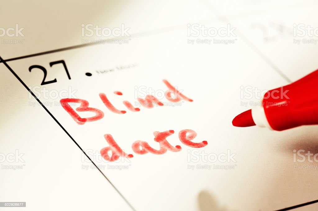 'Blind date' marked in red felt pen on non-specific calendar stock photo