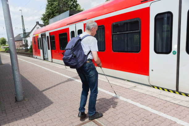 Blind man commuting with train stock photo