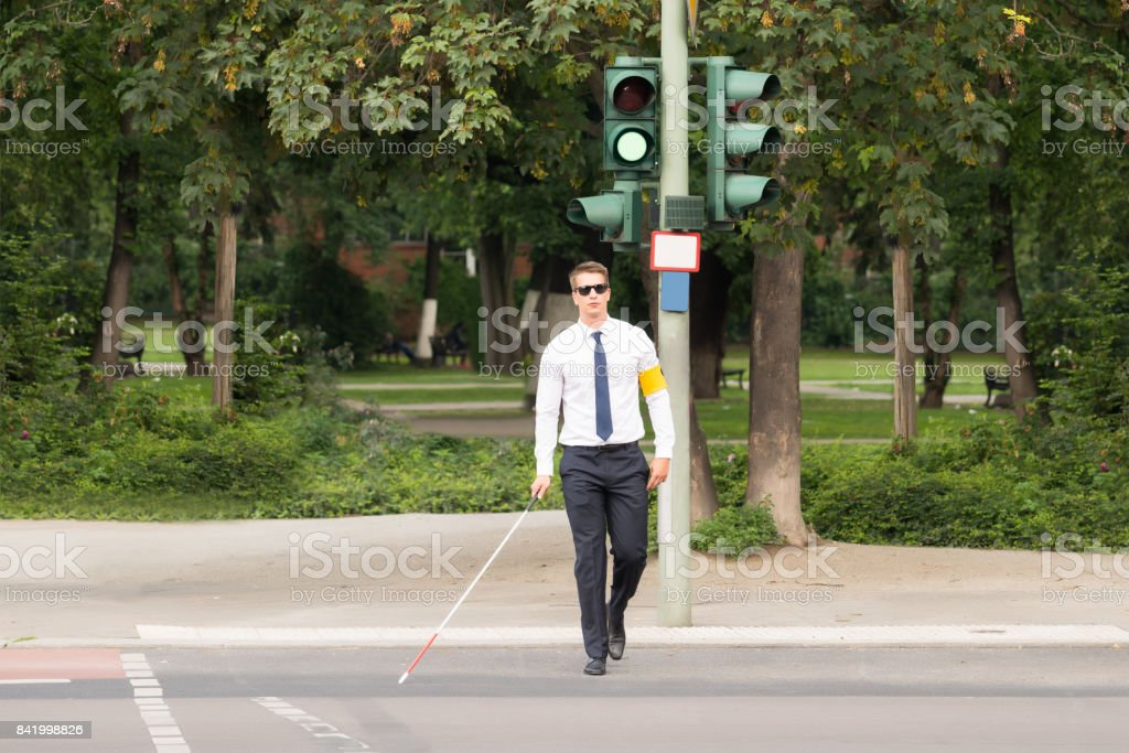 Blind Man Crossing Road stock photo