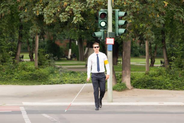Blind Man Crossing Road stock photo