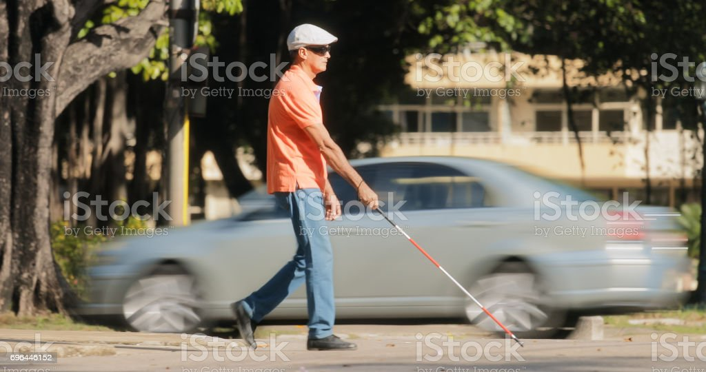 Blind Man Crossing The Road With Cars And Traffic'n stock photo