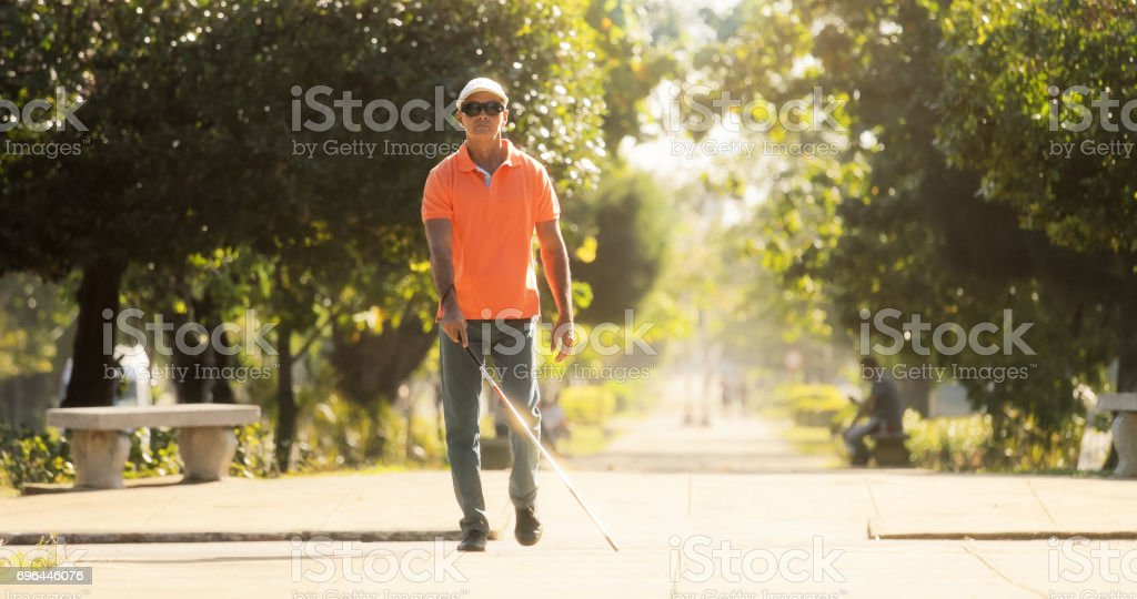 Blind Man Crossing The Street And Walking With Cane'n stock photo