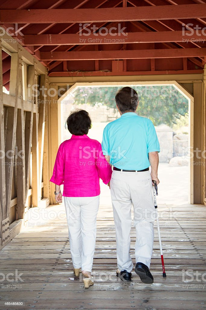 Blind Man Taking a Walk with His Wife stock photo