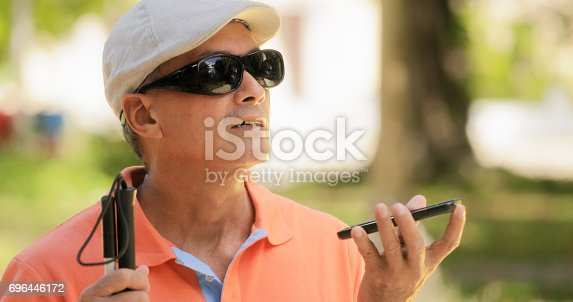 istock Blind Man Talking With Mobile Phone Disabled Man Speaking