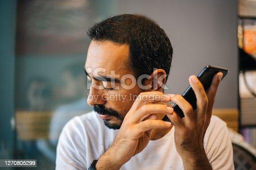 Blind man using technology
