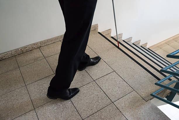 Blind Man Walking Near Stairway stock photo