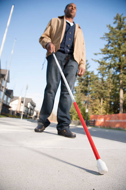 Blind man with walking stick stock photo