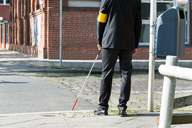 Blind Man With White Stick On Street stock photo