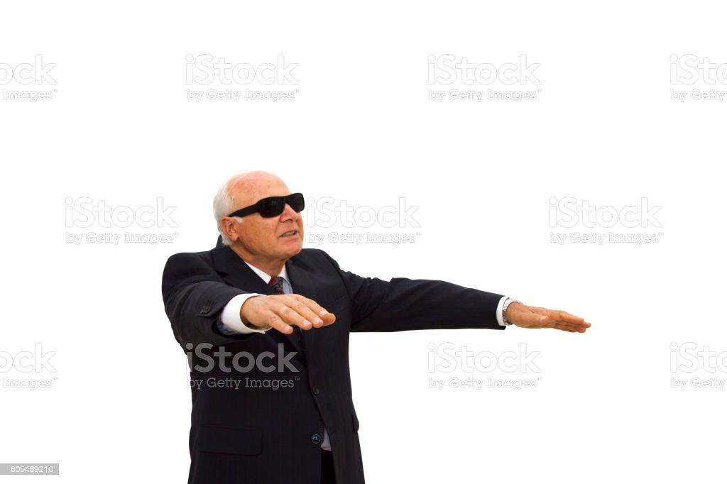 Blind Mature Businessman walking on white background. stock photo