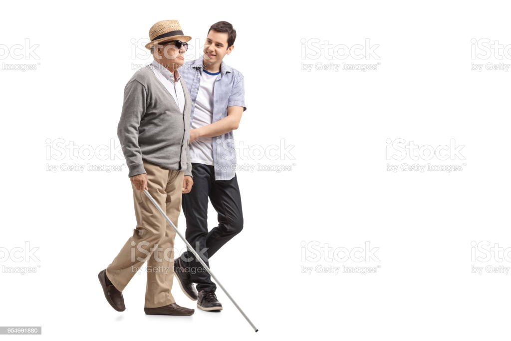 Blind mature man walking with the help of a young man stock photo