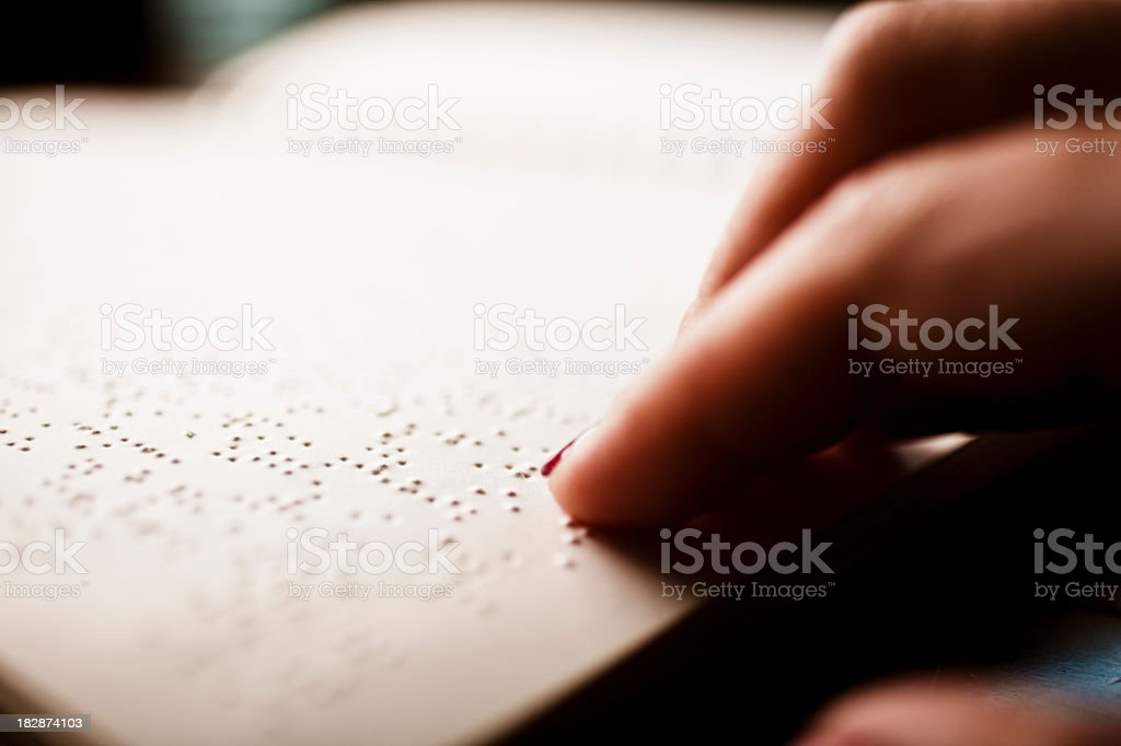 blind person reading. stock photo