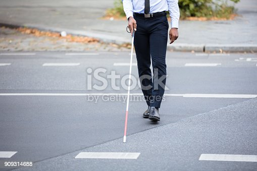 istock Blind Person Walking On Street 909314688