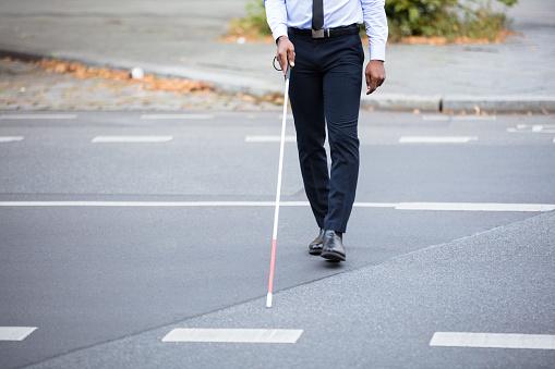 istock Blind Person Walking On Street 909314688