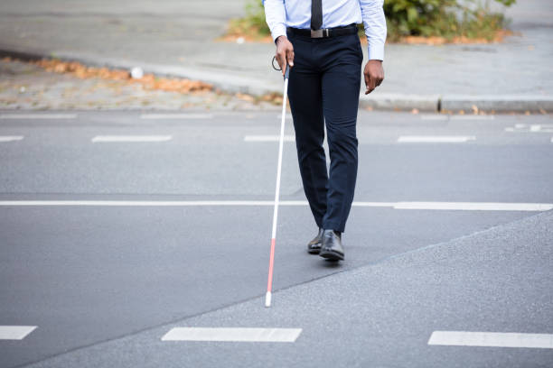 Blind Person Walking On Street stock photo