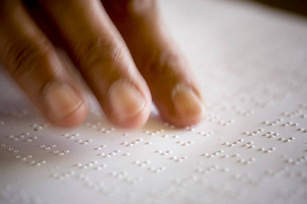 Blind Reading Braille stock photo